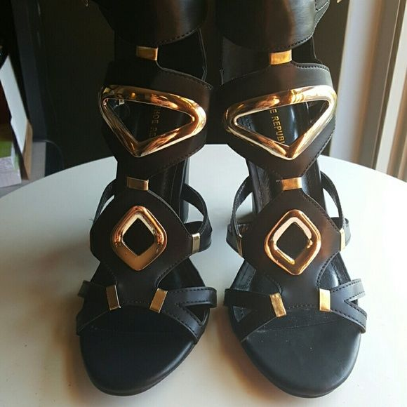 NIB Gold & Black gladiator heels sz 8 Brand new never worn black and gold gladiator heels with back zipper. Gold details and buckles on side of ankle strap. 4 inch heel very very sexy shoe. Shoes Heels