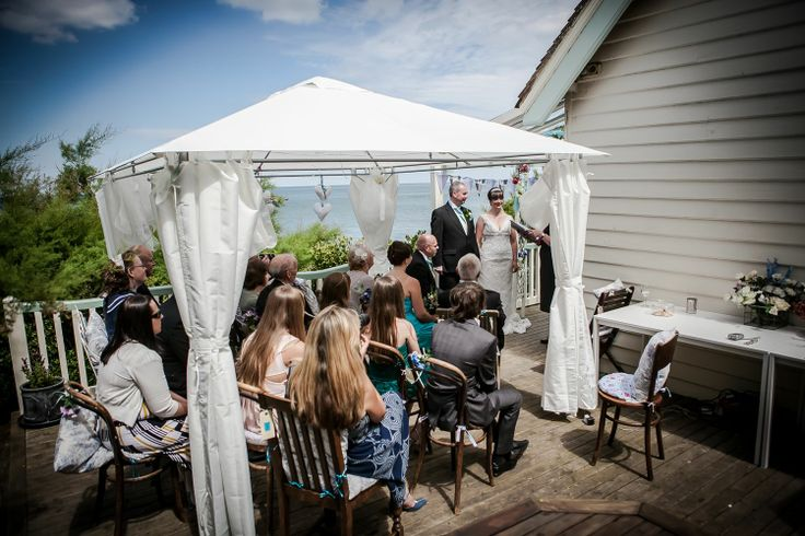 A wider view of the ceremony and the wedding guests out on the terrace at Beacon House.