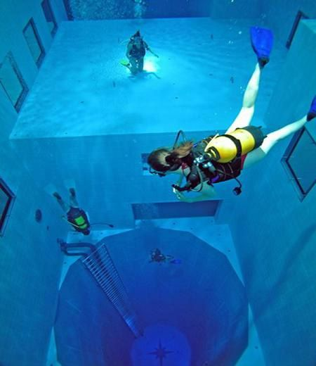 Nemo 33, a recreational scuba diving center in Uccle, Belgium is home to the deepest diving pool in the world. The pool has two large flat-bottomed areas at depth levels of 16 ft and 32 ft, and a large circular pit descending to a depth of 108 ft: Deepest Indoor, Buckets Lists, Nemo33, Deepest Pools, Scubas Diving, Belgium, No 33, Indoor Swim Pools, Brussels