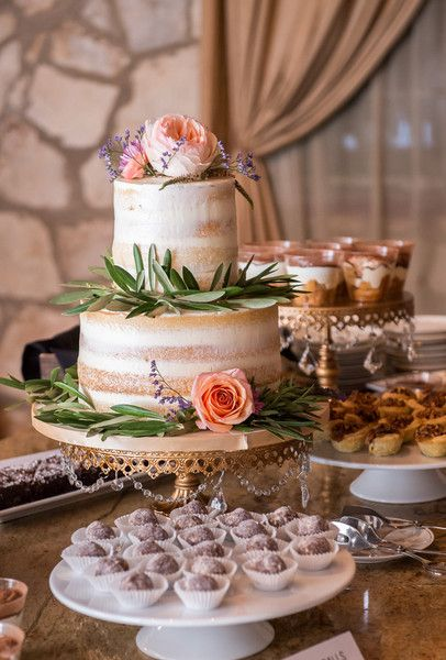 Rustic-chic wedding cake idea - two-tier naked cake with greenery + peach flowers + gold cake stand {Svetlana Photography}