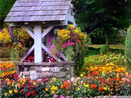I love wishing wells...remind me of Mom & the good things from my childhood...Garden Wishing Well - landscape, wishing well, yard, garden, flowers