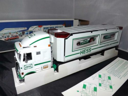 "Vintage 1997 Hess Toy Truck and Racers.A Hess truck with Racers!! That's right you get the 1997 Hess Toy Truck with a pair of push-friction race cars. You get three toys in one! And you can load or unload the racers by unlocking the back door and use the pull down ramp. There are two totally different racers included; one is green with white accents and a ""spoiler"" at the back, the other white with green stripes and an exposed chrome front engine."