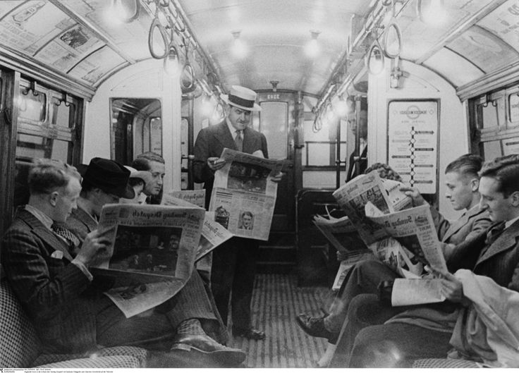 "Englishmen read ""Sunday Dispatch"" in the Subway, 1935 by Erich Salomon"