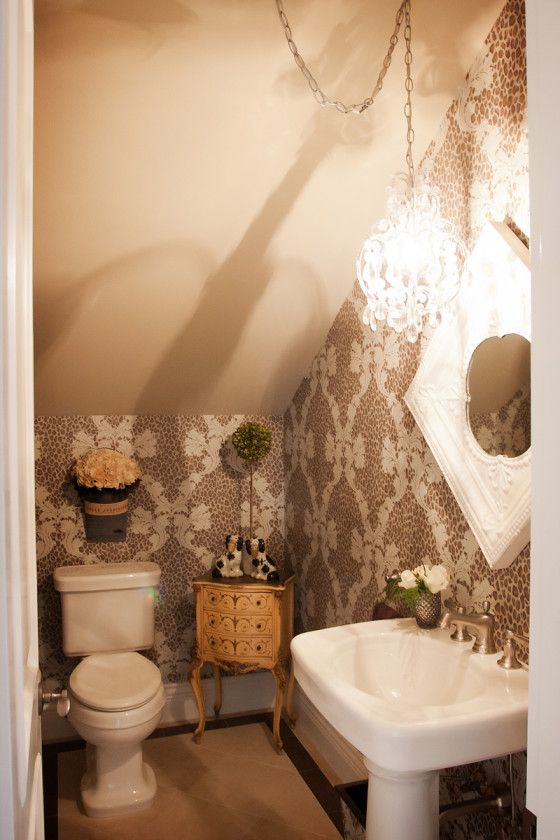 Bathroom in a Small Space - this is a cute little bathroom tucked into the eaves.