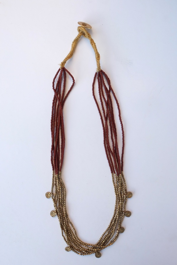 This model combines fine brown glass (available also in green and black) and golden brass and hanging spirals.
