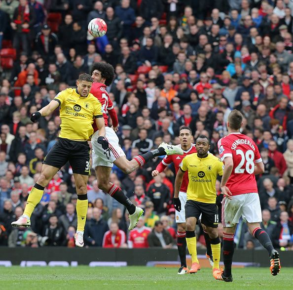 Marouane Fellaini of Manchester United in action with Rudy Gestede of Aston Villa during the Barclays Premier League match between Manchester United...