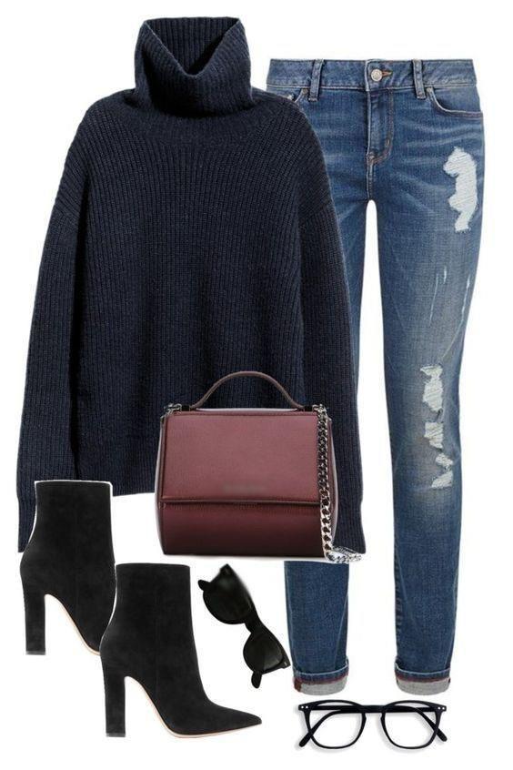 Schwarzer Poncho, dunkle Jeans in der Rue 21 braucht schwarze Stiefel