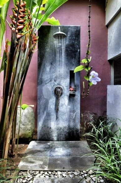 outdoor shower.. Love this one..   Love the natural privacy..  Mine has huge banana trees for privacy..  Beach house needs one..