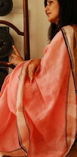 Handwoven Linen saree by Anavila Misra: love the peach colour with golden border