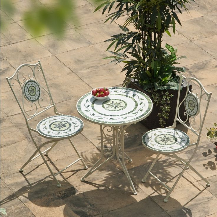 <p>Our Tarragona Cast Iron Bistro Set is constructed with a strong cast iron frame and steel fittings with easy-clean decorative melamine panels. The tabletop and chair panels have an attractive delicate Mediterranean style motif in soft shades of green. The chairs are finished with traditional swirling wrought iron style backs and rounded button feet. Chairs fold flat for easy storage.</p>     <h3> Features:</h3>       <li>Durable melamine easy-clean panels with a delicate Mediter...