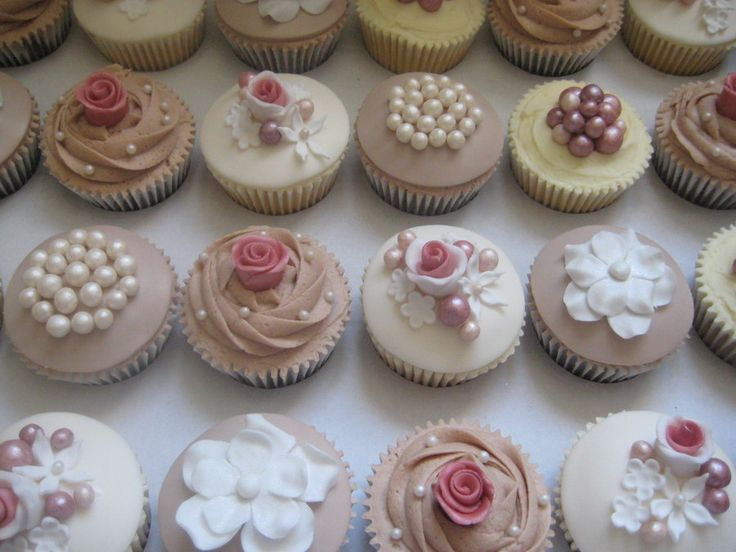 Vintage Wedding cupcakes  add pre made gum paste decor and place in fancy cupcake holders