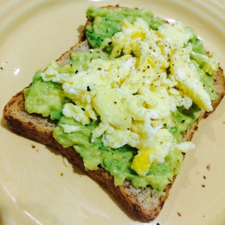 Homemade whole wheat bread toasted with avocado and scrambled egg  #cleaneating
