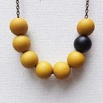 Yellow Beaded Asymmetrical Necklace with Single Black Bead Feature - by EklecticMix on madeit