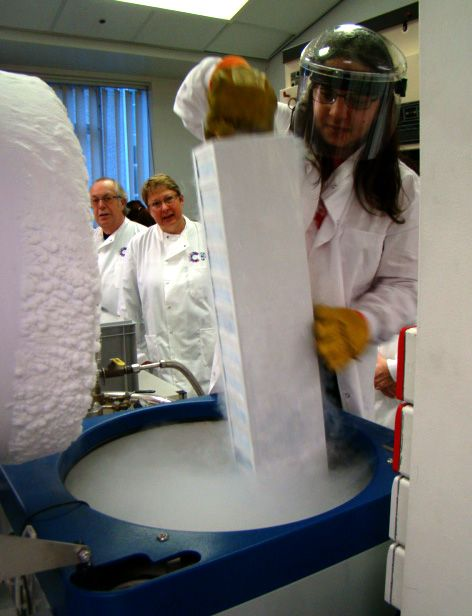 Sameena brings a 'stack' out of the liquid nitrogen that keeps the Haemato-Oncology tissue bank. CR-UK Lab Tour, December 2013. Photo by Natalie Mills