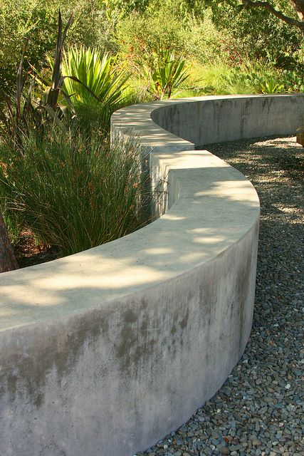 cast in place - sack finish, curving garden wall