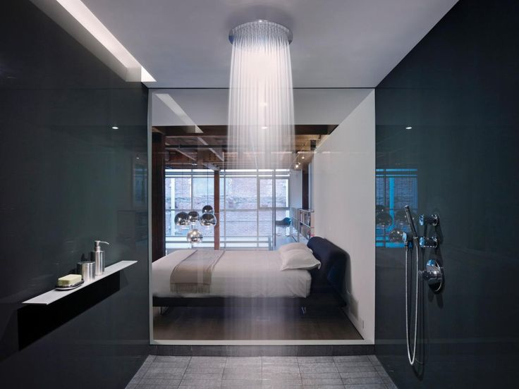 Swapping out your ordinary shower head for a large shower head that simulates rainfall can turn your daily rinse into a serene escape.