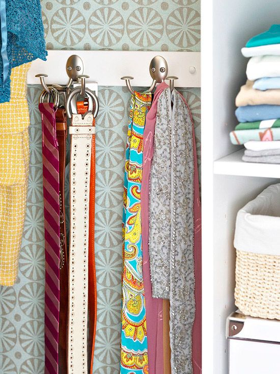 Hang it at a level where the hooks/buckles won't interfere with the clothing. ~ Hidden behind the hanging clothes on the back wall of your closet, this coat-hook rack doubles as a smart belt and scarf hanger in what was untapped closet storage space