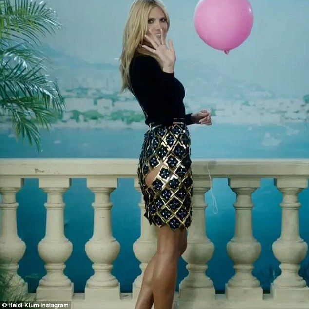 Playful:In the video, Heidi waves and winks at the camera before releasing a pink balloon in her hand as a French song plays in the background complimenting the gorgeous Mediterranean coastline behind her