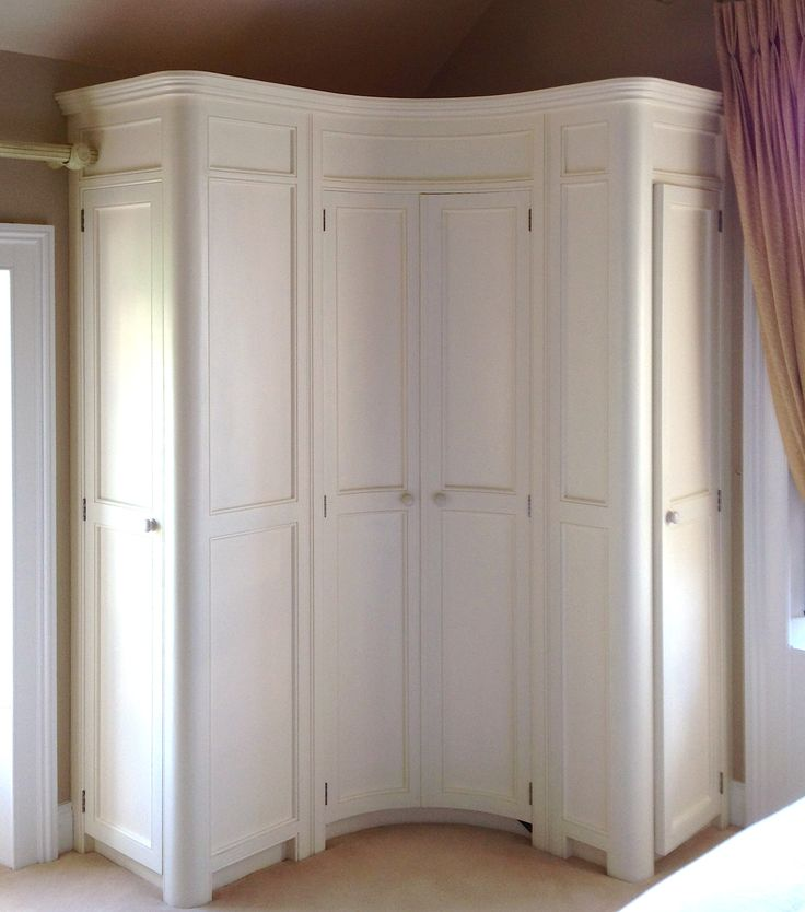 Curved fitted corner wardrobe hand painted in a cream www.linehansdesign.com https://www.facebook.com/LinehansDesign