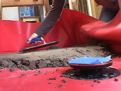 How to Build a Shower Base and Floor : How-To : DIY Network: http://www.diynetwork.com/videos/concrete-shower-base-video/87373.html