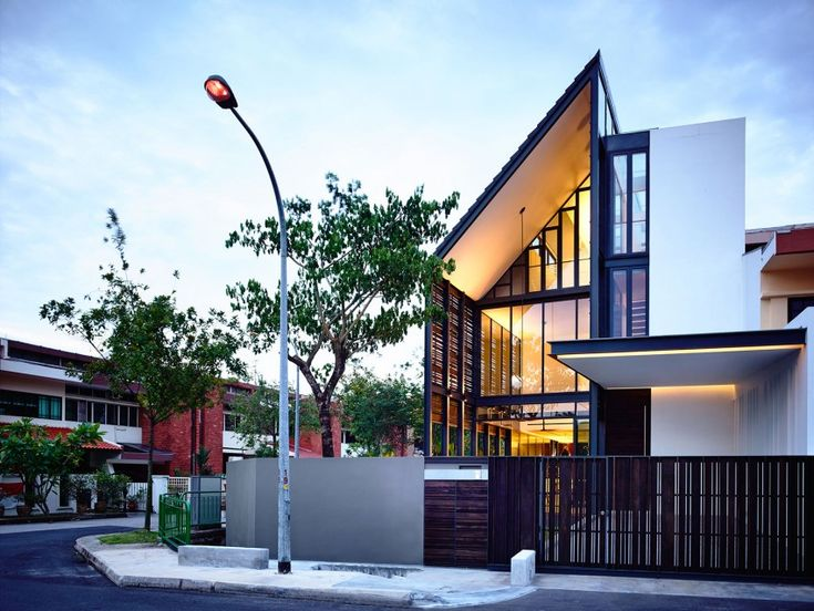 Corner Terrace House Clad in Timber Screens: Lines of Light Residence in Singapore