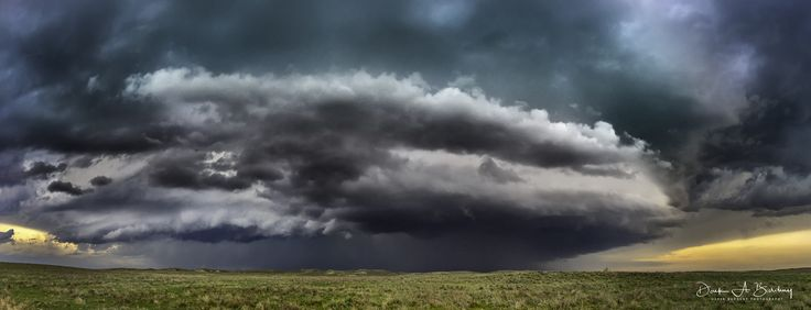 Massive supercell thunderstorm approaches, on the high Colorado plains.