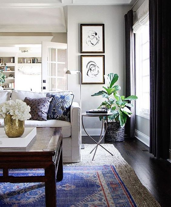 Bohemian style rug layering, boho chic living rooms and bedrooms, eclectic wordly interior design style, and global inspired room decor, layered rugs, and colorful rugs.