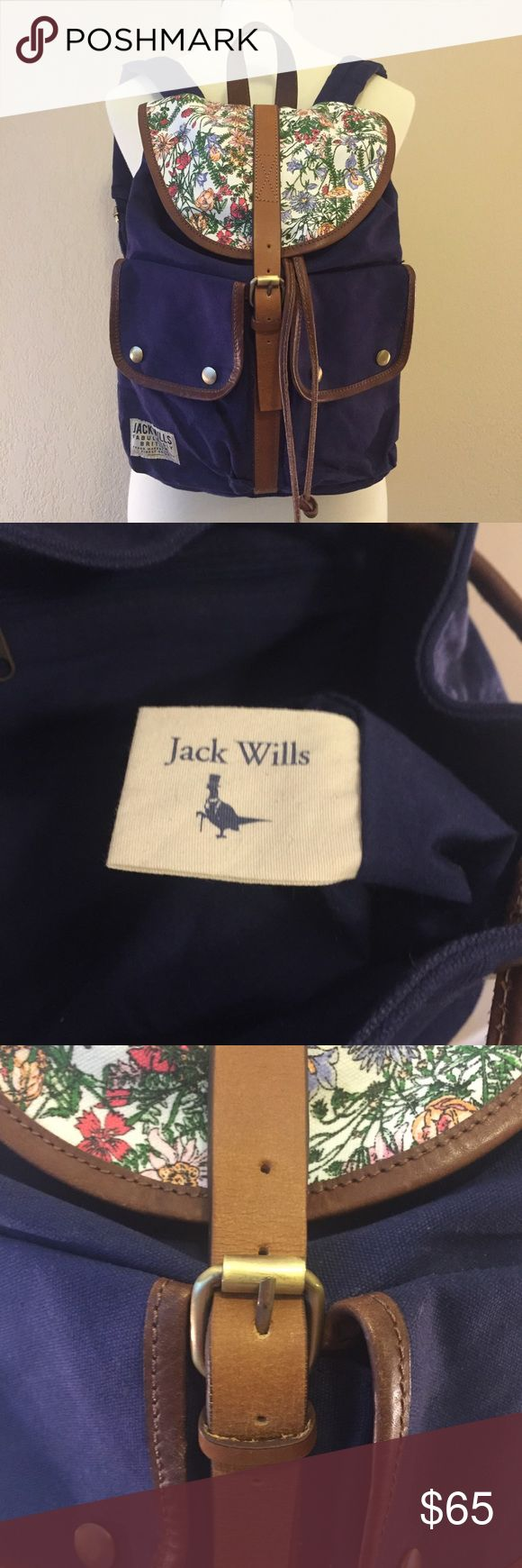Jack Wills Floral Navy Buckle Drawstring Backpack Jack Wills Navy backpack with floral flap that buckles. Underneath the flap, the bag also has a drawstring closure. Two exterior pockets with snaps and one zipped interior compartment. Adjustable straps. 100% cotton shell and lining. Gently used and in great condition!! Very light wear to the leather strap that is used to buckle the bag and to the drawstrings. Both fabric interior and exterior are clean and in like new condition. Easily fits…