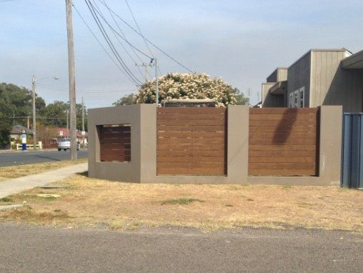 Brick Pier Fence with hard wood timber in fills render finish with a feature hard wood widow. Ocean Beach Road Woy Woy.