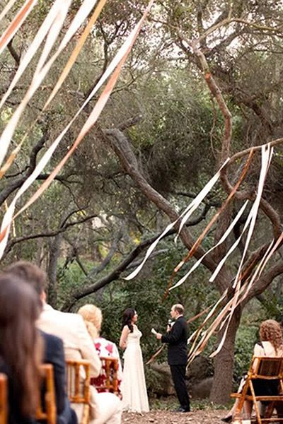This is a nice idea. It's a good way to incorporate the colours of your wedding while still maintaining a natural theme.
