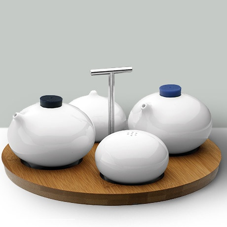 Loveramics condiment set - salt shaker, a pepper shaker, an oil jug and a balsamic vinegar jug, all nestled comfortably together on a bamboo placemat