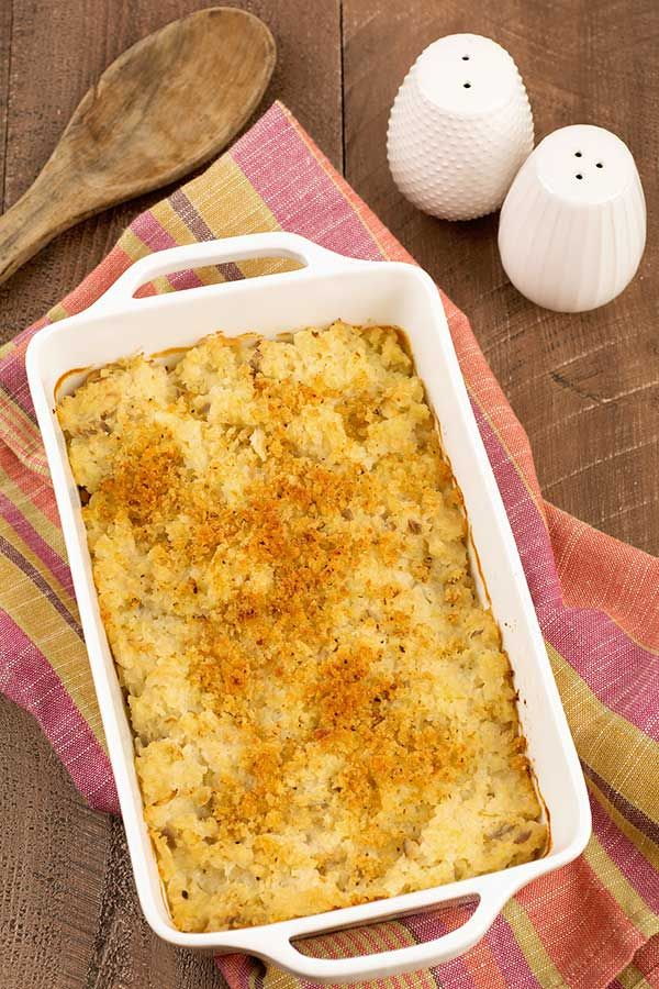 This easy cauliflower gratin recipe is made with frozen riced cauliflower and makes a delicious, low-carb alternative to potatoes or pasta.