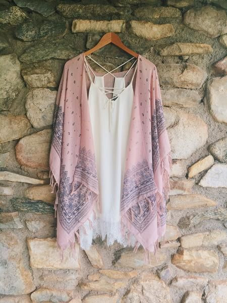 Paisley Tassel Kimono - Livin' Freely This Paisley Tassel Kimono features gorgeous paisley print, along with a tassel trim. This is the perfect piece to transition that Summer wardrobe into Fall!