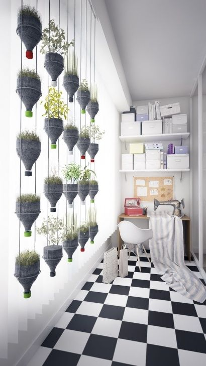 Modern hanging plants wall from recycled plastic bottles
