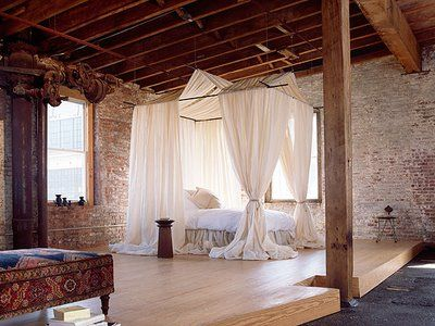 fantasy loft bedroom...exposed white washed brick, exposed beams, open concept floorplan, big windows, spacious, minimal furniture and of course that loft bed