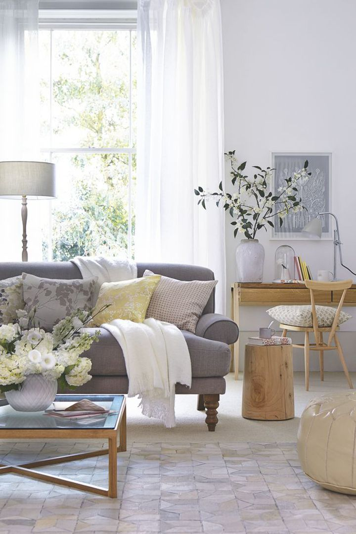 Living Room.   Love the sofa....the shade of gray and the legs.  Pillows make it all look inviting.