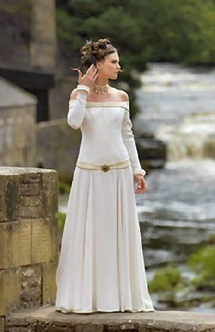 unusual wedding gowns Love. So simple and with a slightly Celtic feel
