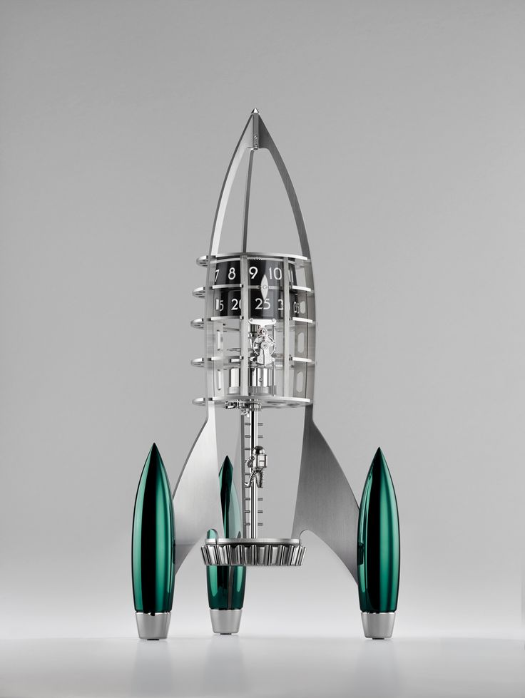 Developed specifically for Destination Moon, the architecture of L'Epée's eight-day movement follows the basic design of a real spaceship. the power for Destination Moon comes from the oversized winding crown in its base. The management and control systems of a rocket are above the power source; the same holds true for Destination Moon, which has a vertical regulator below the time display, as well as a time-setting knob at the top of the movement.