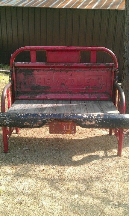 My husband made this out of an old metal bed frame and an old 56 Chevy tail gate and bumper.