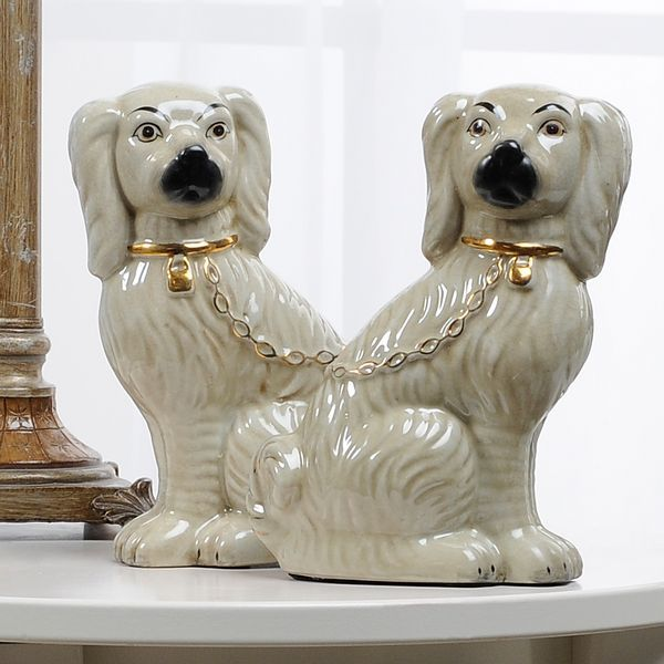 Dying for a pair of antique Staffordshire dogs... Want them to have chain leashes like these, pretty faces, and either all white or black and white spotted. :)