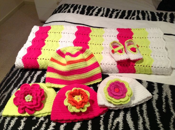 Multicolour baby blanket and beanies. New born