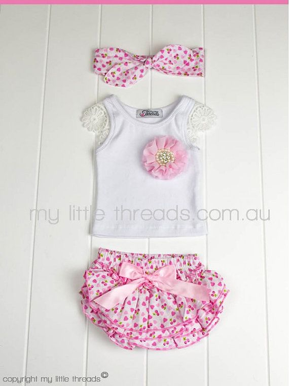 This set includes a pair of beautiful floral print rufflebum bloomers, singlet embellished with a vintage pink rhinestone flower and matching