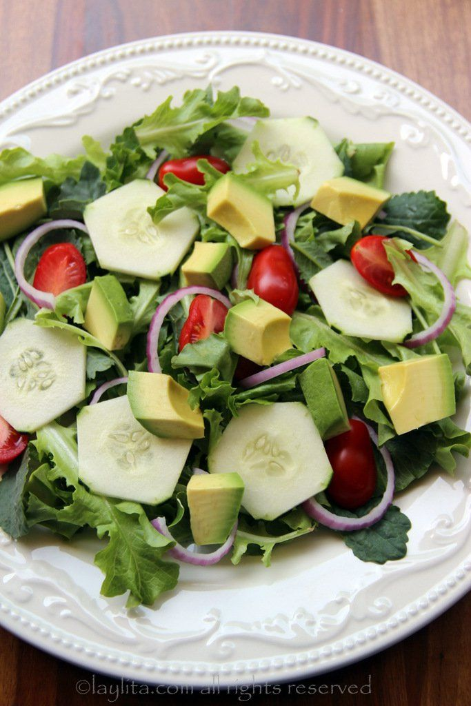Mixed salad greens, cucumbers, onions, tomatoes and avocado