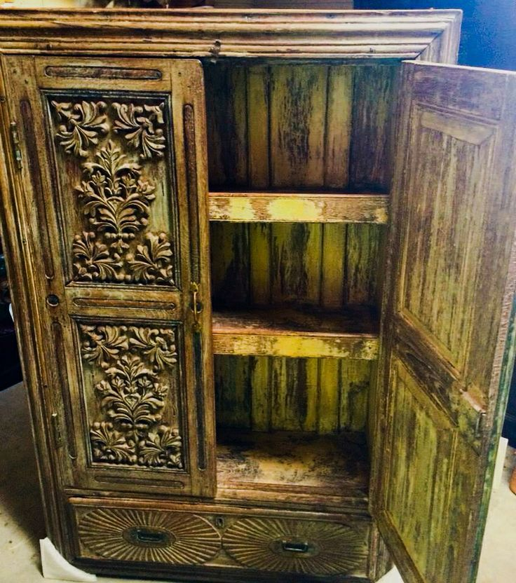 Antique wooden 'Almirah' a traditional free standing cupboard used in many areas around India. This one has beautiful hand-carved wooden door panels. Unusual log panels have been used for the reverse.