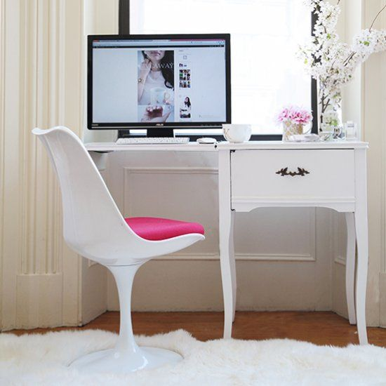 Transform an old sewing machine cabinet into this chic and elegant work desk. All you need is a layer of some fresh white paint!