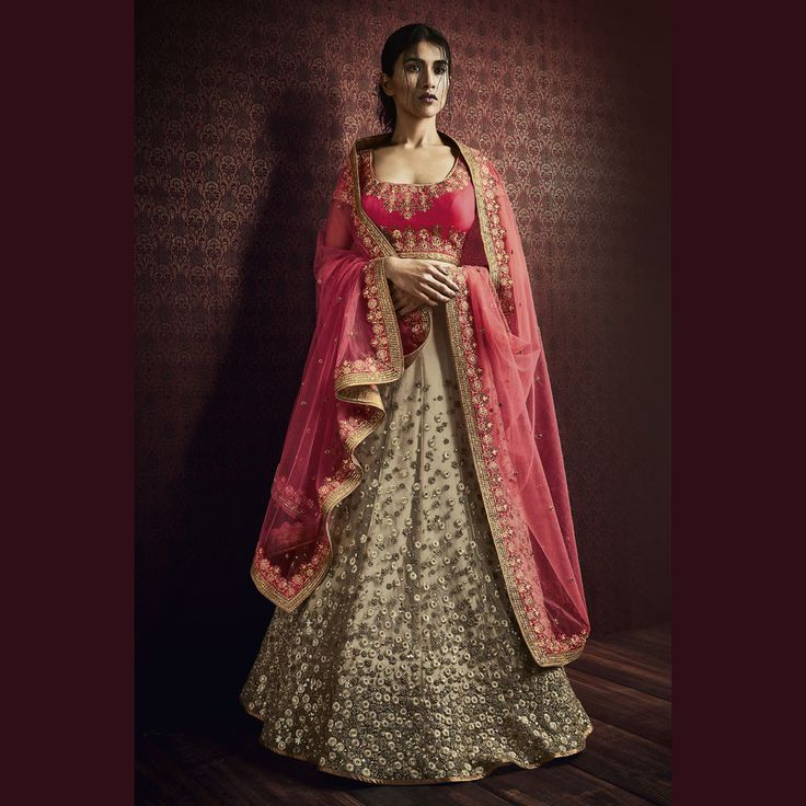 Net Skirt with Heavy Bootis Work Bridal Wedding Lehenga Saree in Beige Color. Buy Now :- https://goo.gl/TsFu3K COD & Free Shipping available in INDIA.