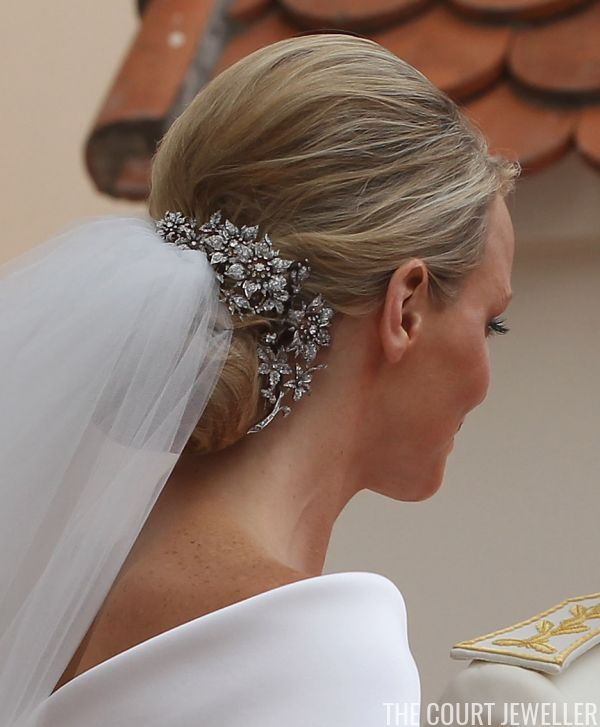 """One of the most effective uses of brooches as a hair ornament was Princess Charlene of Monaco's wedding day hairstyle in 2011. Charlene clarified her wedding hair ornament decision to Vogue Magazine: """"I'm not wearing a tiara. Instead, Princess Caroline has lent me some beautiful diamond hair clips which belonged to her grandmother."""" That grandmother is Princess Charlotte, Duchess of Valentinois -- mother of Prince Rainier III of Monaco."""