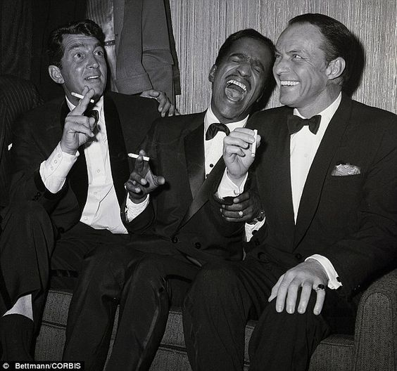Party time (l-r): Dean Martin, Sammy David Jr and Frank Sinatra relax off-stage in 1961. The Rat Pack were regulars at Ole Blue Eyes' pentho...: