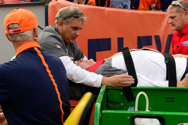 Chargers vs. Broncos:  October 30, 2016  -  27-19, Broncos  -        Denver Broncos defensive coordinator Wade Phillips is carted off after being knocked down during a play on the sidelines against the San Diego Chargers during the first quarter on Sunday, October 30, 2016. The Denver Broncos hosted the San Diego Chargers.