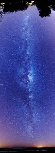 A Tall Milky Way Flickr by Luis Argerich. A Vertical panorama of the Milky Way after twilight. The central bulge of the Milky Way is clearly visible at Sagitarius. The great rift in the middle and the dark coalsack nebula are also visible contrasting against the bright sky.